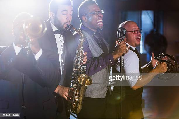 jazz band performing at a nightclub - performance group stock pictures, royalty-free photos & images
