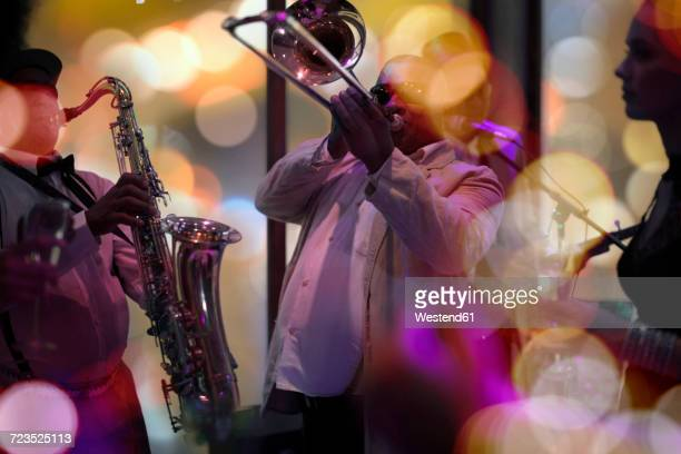 jazz band playing - arts culture and entertainment stock pictures, royalty-free photos & images
