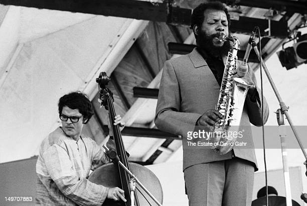 Jazz bassist Charles Haden and jazz saxophonist bandleader and composer Ornette Coleman perform at the Newport Jazz Festival in July 1971 in Newport...