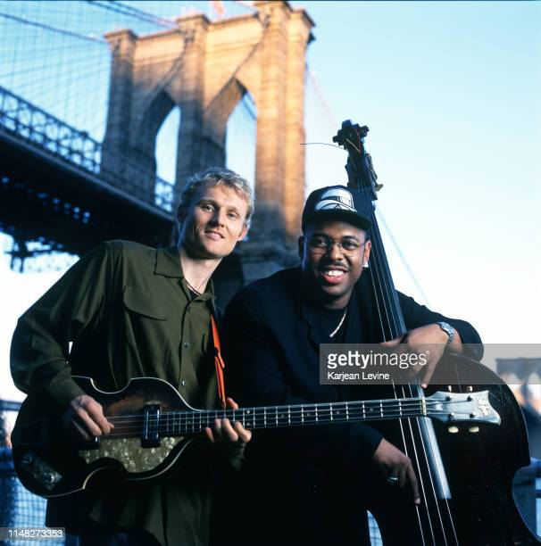 Jazz bassist Christian McBride poses for a joint portrait with bassist Chris Wood of the jazz trio Medeski Martin and Wood at the Brooklyn Bridge on...