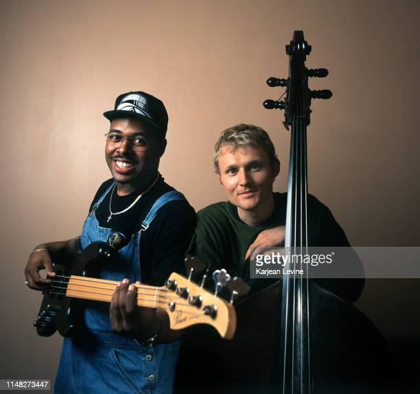 Jazz bassist Christian McBride poses for a joint portrait with bassist Chris Wood of the jazz trio Medeski Martin and Wood on July 1 1998 in New York...