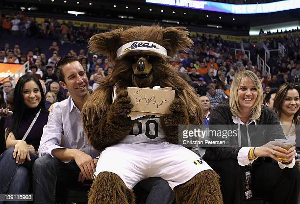 Jazz Bear mascot for the Utah Jazz holds up a sign as he sits with fans during the NBA game between the Atlanta Hawks and the Phoenix Suns at US...