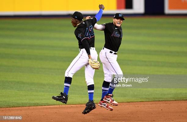 Jazz Chisholm Jr. #2 and Miguel Rojas of the Miami Marlins celebrate after defeating the San Francisco Giants by score of 4-1 at loanDepot park on...