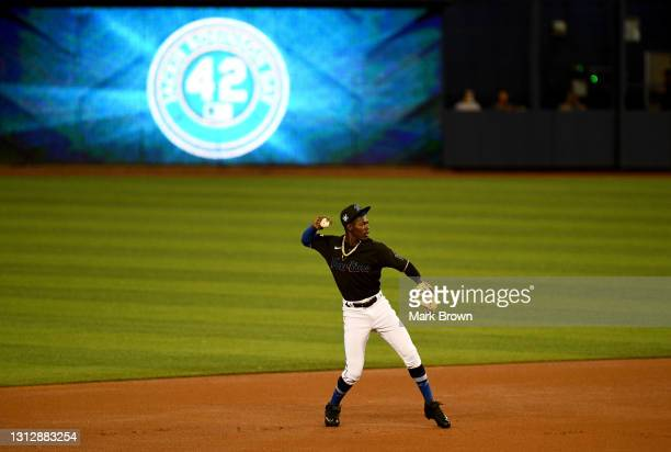 Jazz Chisholm Jr. #2 of the Miami Marlins makes a throw to first bases prior to the start of the first inning against the San Francisco Giants at...