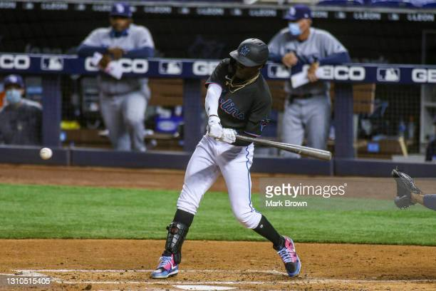 Jazz Chisholm of the Miami Marlins singles for his first major league hit in the fifth inning against the Tampa Bay Rays at loanDepot park on April...