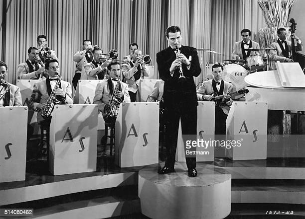 Jazz clarinetist Artie Shaw leads his band during a scene from the movie Second Chorus in 1940