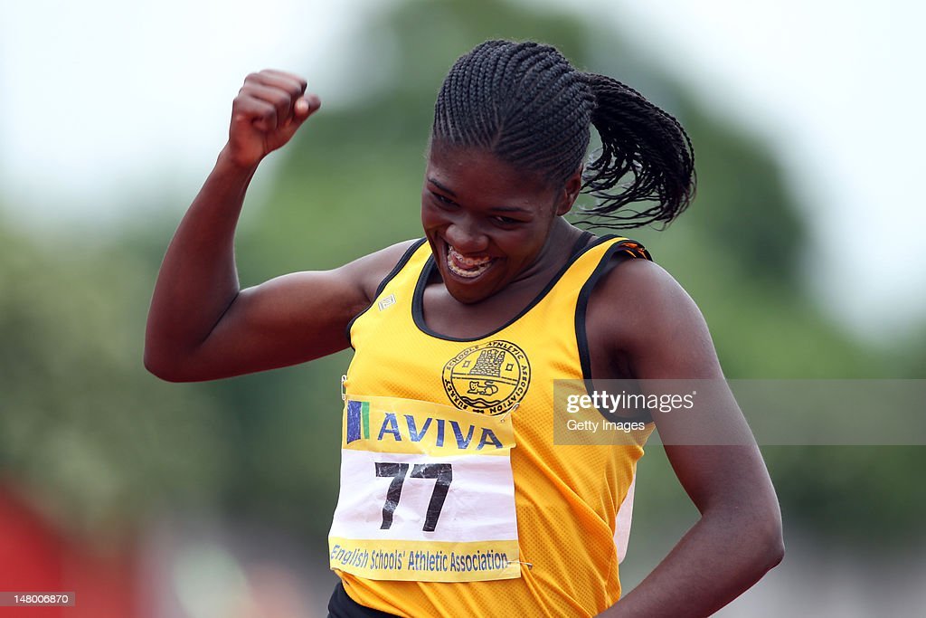 Jazz Crawford of Surrey brings home the batton for victory in the