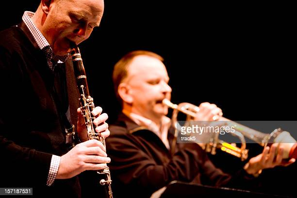 jazz dixieland clarinet and muted trumpet duet - duet stock pictures, royalty-free photos & images