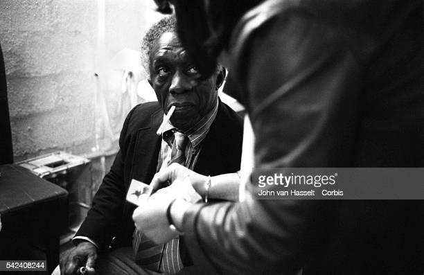 Jazz drummer Art Blakey smokes a cigarette backstage at the New Morning club in Paris France