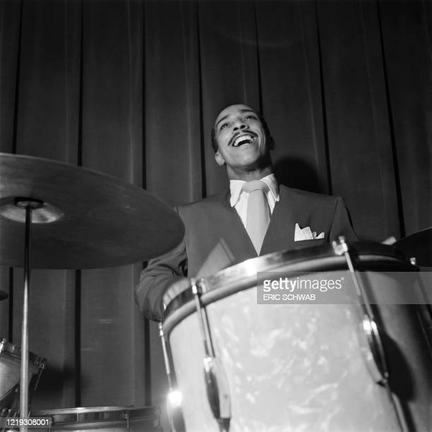 Jazz drummer J.C. Heard plays drums on stage with US pianist Pete Johnson and his jazz orchestra, at the Café Society Downtown night club in November...