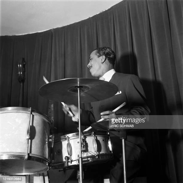 Jazz drummer J.C. Heard plays drums on stage with US pianist Pete Johnson and his jazz orchestra, at the Café Society Downtown jazz night club in...