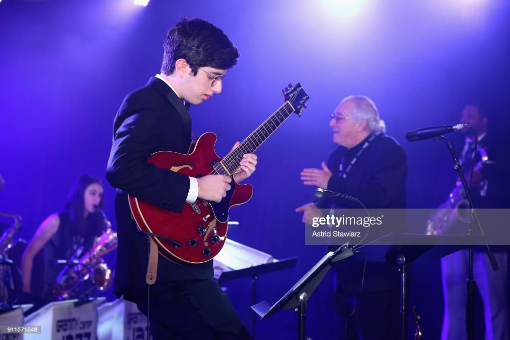 Jazz Education Hall of Fame inductee Justin DiCioccioco conducts GRAMMY Camp®-Jazz Session students as they perform at the 60th Annual GRAMMY Awards Celebration at Marriott Marquis Hotel on January 28, 2018 in New York City.