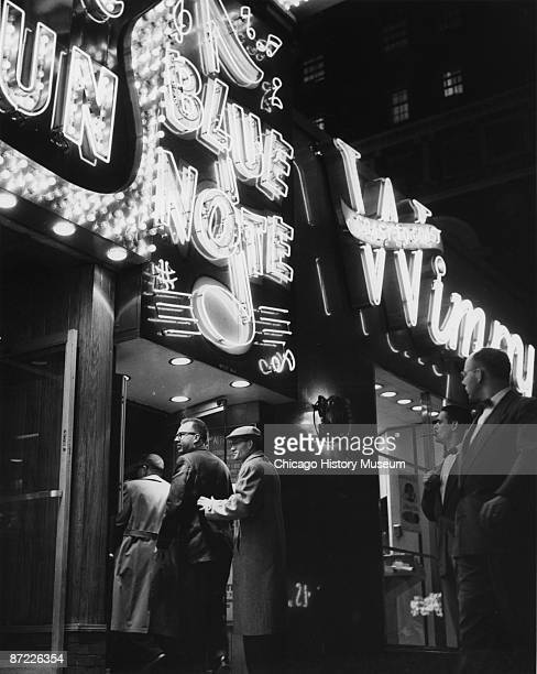 Jazz fans enter the Blue Note Cafe under its bright marquee Chicago 1955