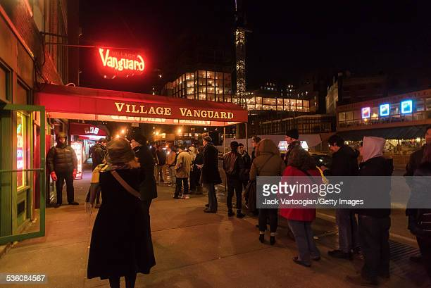 Jazz fans line up on the sidewalk outside at the Village Vanguard for a late set by the Bad Plus New York New York January 1 2015