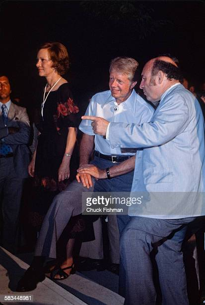 Jazz festival producer George Wein encourages President Jimmy Carter to go onstage and participate in a White House Jazz Concert on the South Lawn...