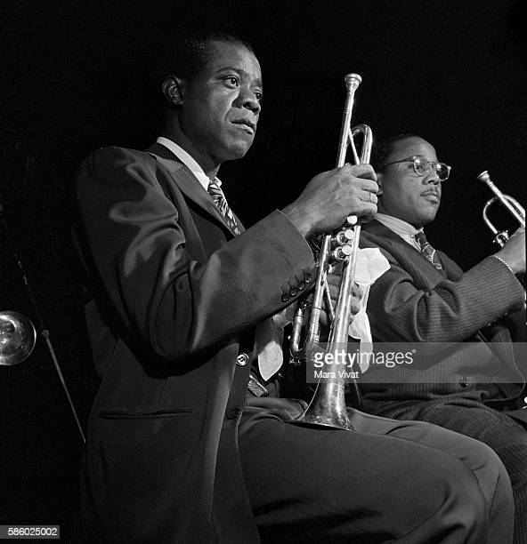 Jazz great Louis Armstrong holds his trumpet