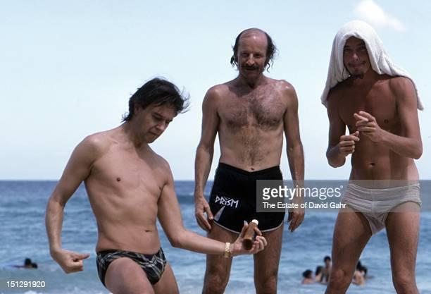 Jazz guitarist John McLaughlin, jazz keyboardist Joe Zawinul, and jazz electric bassist Jaco Pastorius pose for a fun portrait while relaxing at a...