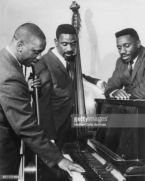 Jazz guitarist Wes Montgomery with brothers bassist Monk Montgomery and vibraphonist Buddy Montgomery pose for a photo circa 1962