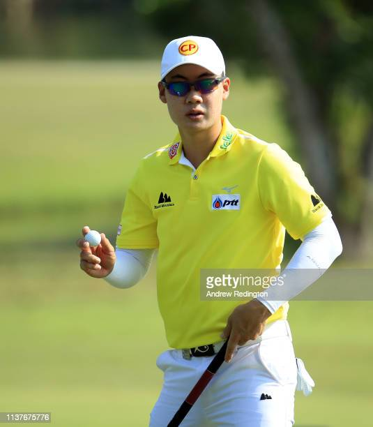 Jazz Janewattananond of Thailand celebrates his birdie on the first hole on Day Three of the Maybank Championship at Saujana Golf Country Club Palm...