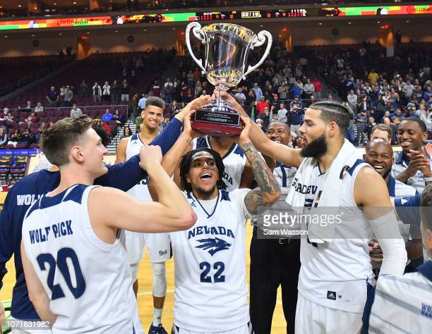 Jazz Johnson and Cody Martin of the Nevada Wolf Pack hold up the championship trophy after they defeated the Massachusetts Minutemen 11087 to win the...
