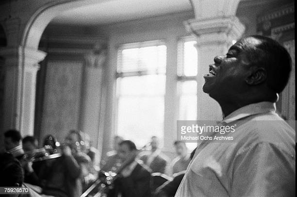 Jazz legend Louis Armstrong performs at Kay Chapel of Trinity Church the weekend of the American Jazz Festival in July 1958 in Newport, Rhode Island.