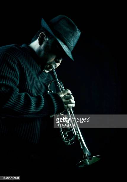 jazz man - trumpet stock photos and pictures
