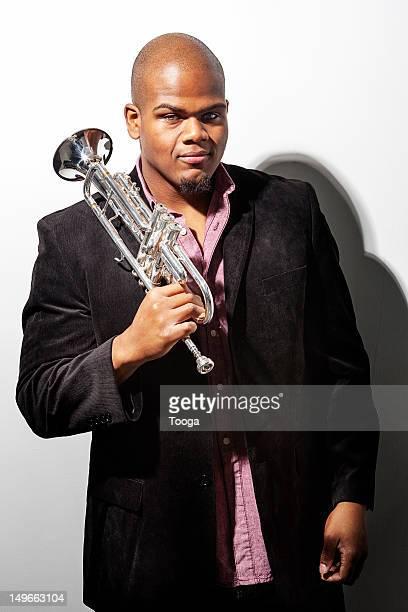 Jazz Musican holding trumpet over his shoulder
