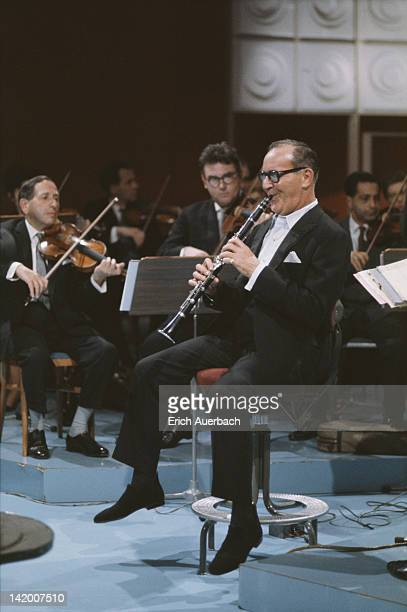 Jazz musician and band leader Benny Goodman playing the clarinet with a string ensemble 1960