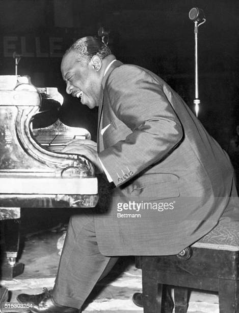 Jazz musician and bandleader Count Basie plays the piano during a performance in Manchester