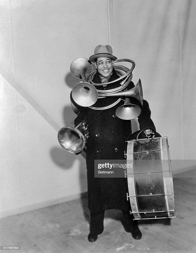 Jazz Musician Duke Ellington Carrying Horns and Drum