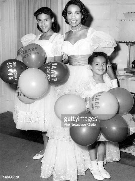 Jazz musician Harry Belafontes wife Marguerite Belafonte and daughters carrying a large number of balloons during an NAACP Freedom Drive 1958