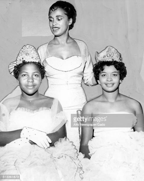 Jazz musician Harry Belafontes wife Marguerite Belafonte and Patricia Godbolt crowning a beauty pageant winner Norfolk Virginia October 24 1959 Miss...