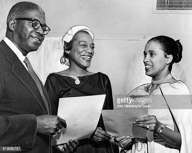 Jazz musician Harry Belafontes wife Marguerite Belafonte and Russell P Crawford standing and receiving an award October 5 1958