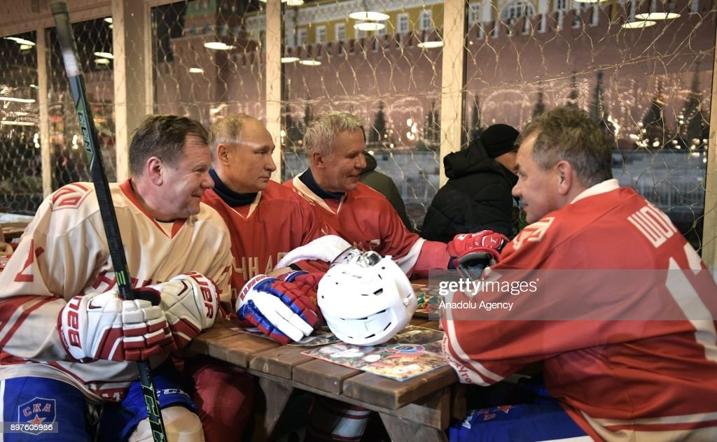 Jazz musician Igor Butman, Russia's President Vladimir Putin, Russian State Duma member Vyacheslav Fetisov, and Russia's Defence Minister Sergei Shoigu (L-R) are seen in a Night Hockey League match on the GUM skating rink in Moscow's Red Square in Moscow, Russia on December 23, 2017.