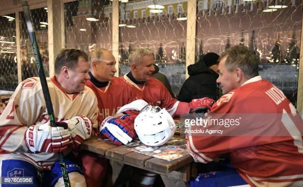 Jazz musician Igor Butman Russia's President Vladimir Putin Russian State Duma member Vyacheslav Fetisov and Russia's Defence Minister Sergei Shoigu...