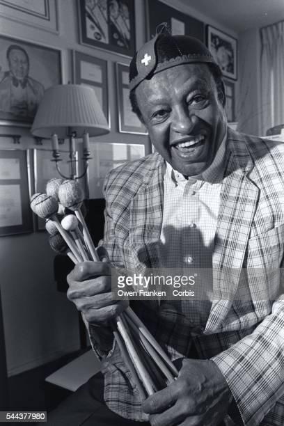 Jazz musician Lionel Hampton holds a handful of Vibraphone sticks