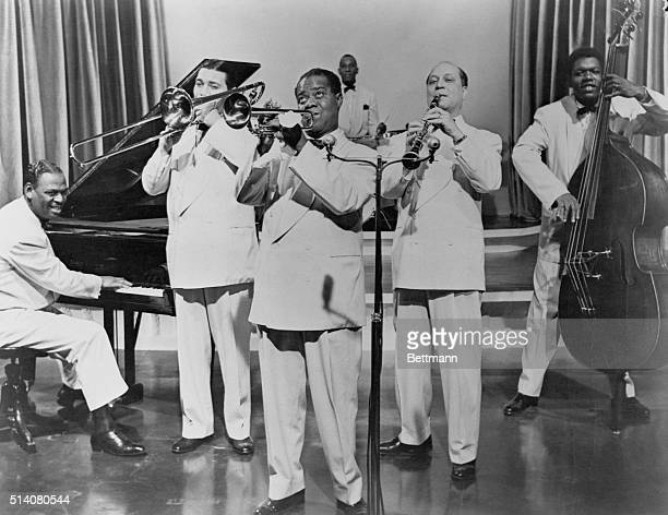 Jazz musician Louis Armstrong performing with his band Undated photograph