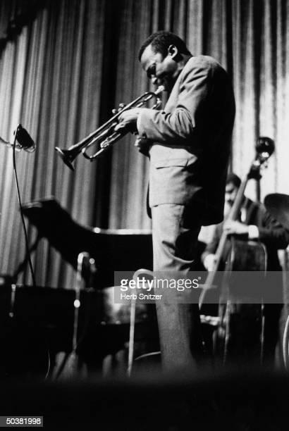 Jazz musician Miles Davis performing at the Apollo Theater.