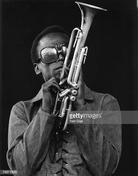 Jazz musician Miles Davis plays his trumpet at the Newport Jazz Festival in 1969 in Newport Rhode Island