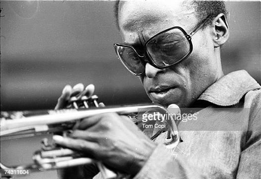 Jazz musician Miles Davis plays his trumpet at the Newport Jazz Festival in 1969 in Newport Rhode Island