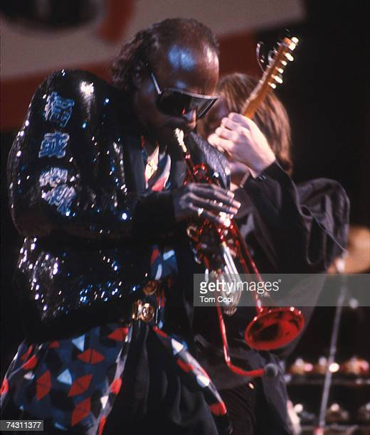 Jazz musician Miles Davis plays his trumpet onstage in circa 1988