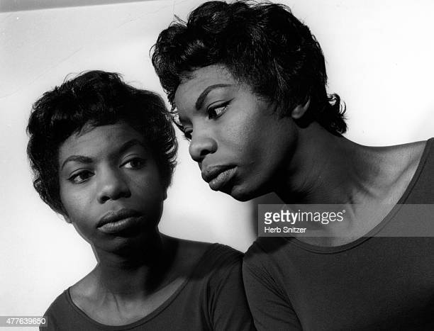 Jazz musician Nina Simone poses for a portrait session at home in 1959 in Phialdelphia PA
