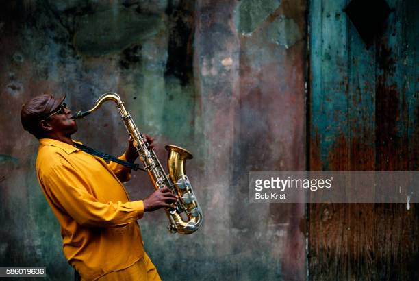 jazz musician playing saxophone - jazz stock pictures, royalty-free photos & images