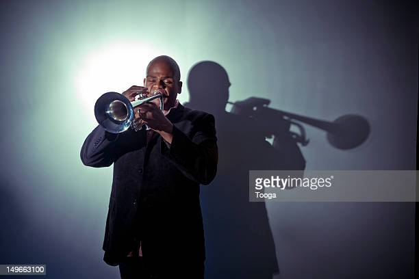 Jazz musician playing trumpet with spotlight