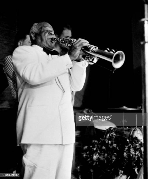 US Jazz musician Sidney Bechet performs in Antibes on August 17 1951 during the celebration of his third marriage with Elisabeth Ziegler / AFP PHOTO /