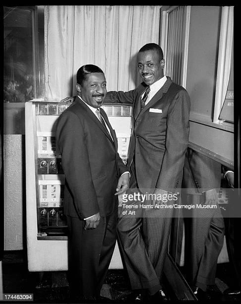 Jazz musicians Erroll Garner and Leroy Brown standing beside cigarette machine in Crawford Grill No 2 Pittsburgh Pennsylvania 1962