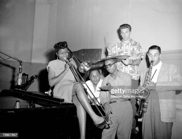 Jazz musicians LR Melba Liston Charles Fox Chuck Thompson Ross Russell and Dexter Gordon joke around during a Dial Records recording session on June...