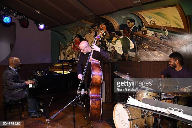 Jazz musicians Orrin Evans Ben Wolfe and Mark Whitfield Jr perform on stage during the 2016 SESAC Jazz Awards on January 12 2016 in New York City