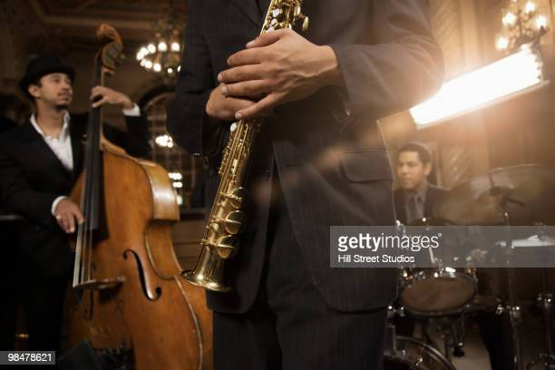 jazz musicians performing in nightclub - jazz stock pictures, royalty-free photos & images
