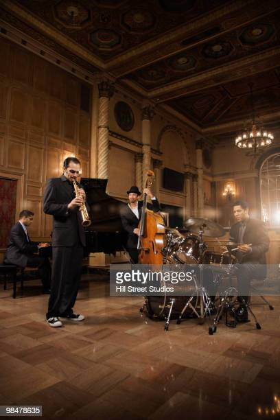 jazz musicians performing in nightclub - pianist front stock pictures, royalty-free photos & images